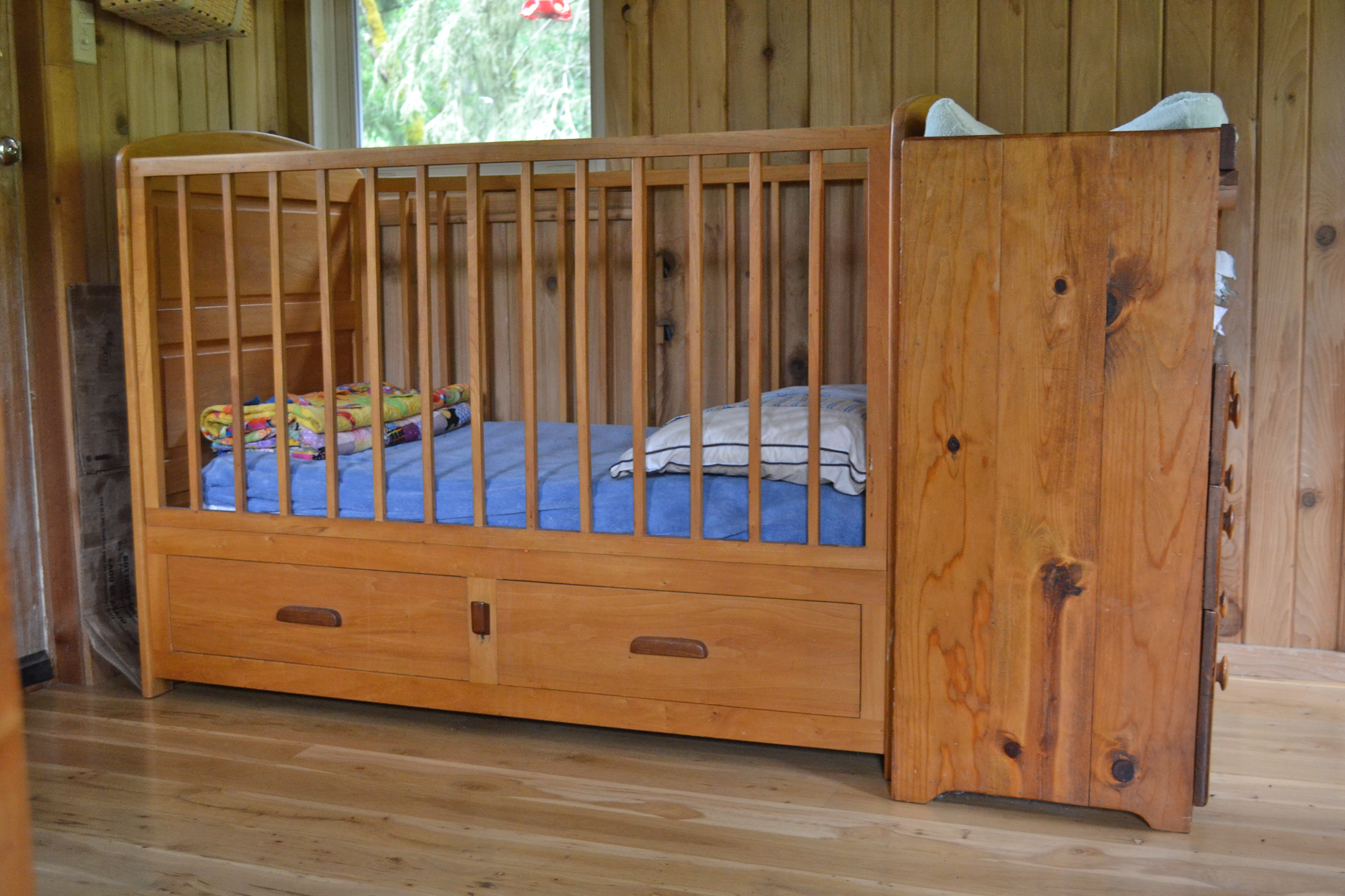 Two kids in one bed and a tour of cabin living quarters for Cradle bed for adults