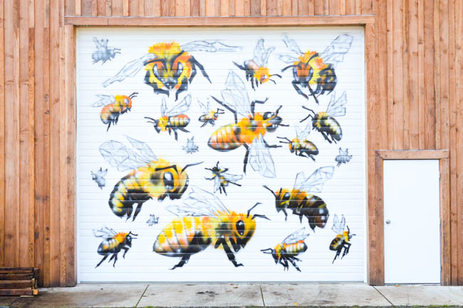 Honeybee Mural by artist Manny Arechiga at Old Blue Raw Honey in Philomath, OR